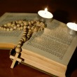 Wooden cross over bible with candles — Stock Photo #9331156