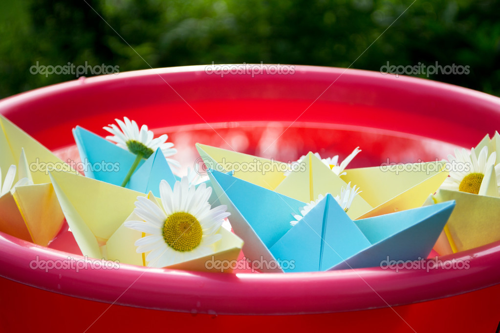 Sweet sailboats in paper with daisies on board  Stock Photo #12014967