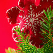 Stock Photo: Red and woolly snowflake...