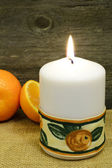 Candle and clementines... — Stock Photo