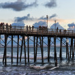 On Oceanside pier watching waves in the afternoon — Stock Photo #13690873