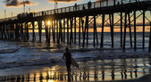 Surfer watching an Oceanside California sunset. — Stock Photo