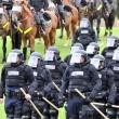 Modern day gladiators - police officers in riot gear respond to the civil disturbance — Stock Photo