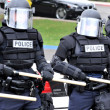 Moving toward the riot - police officers in protective gear — Stock Photo