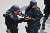 Police Officers in full protective gear respond to a civil disturbance — Stock Photo
