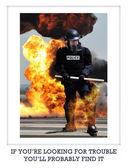 Member of police in riot gear — Stock Photo