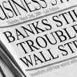 Newspaper headlines read &amp;#039;Banks Still in Trouble On Wall Street&amp;#039; - Stock Photo