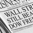 Newspaper reads &amp;#039;Wall Street Still Bearish - Dow Freefall&amp;#039; - Stock Photo