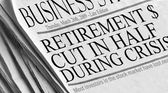 Newspaper headlines read 'Retirement Cut in Half During Crisis'. — Stock Photo