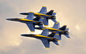 Angels flying in tight diamond formation at a public airshow. — Stock Photo