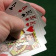 Revealing part of a good poker hand — Zdjęcie stockowe