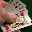 Revealing part of a good poker hand — Stockfoto