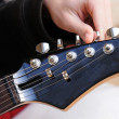 Tuning an electric guitar — Stock Photo #15763451