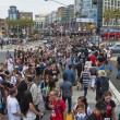 Stock Photo: SAN DIEGO, CALIFORNI- JULY 13: Crowds of participants cross street in gaslamp district while at Comicon in Convention Center on July 13, 2012 in SDiego, California.