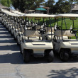 Line of golf carts - several pairs of carts waiting for a game of golf on a clear blue sunny day in Southern California. — Stock Photo #17598649