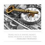 Golden key and clock on top of US dollar bills — Stock Photo