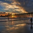 Surfers Walking Out Oceanside Pier Sunset — Stock Photo #24953787
