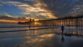 Surfers Walking Out Oceanside Pier Sunset — Stock Photo