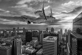Airplane above city — Stock Photo