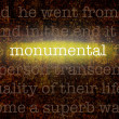 Word MONUMENTAL over grungy background — Stock Photo