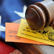 Stock Photo: Ellow and orange playing card with gavel atop US flag