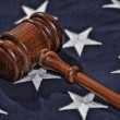 Gavel atop stars and blue portion of flag — Stock Photo