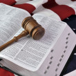 Wooden gavel, Bible, and flag — Stock Photo #38781345