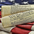 Stock Photo: US Constitution and flag background.