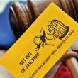 Stock Photo: Yellow playing card with gavel atop US flag