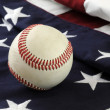 Stock Photo: Baseball and flag