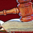 Stock Photo: Gavel over weathered book