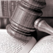 Foto Stock: Wooden gavel atop literature