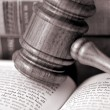Stockfoto: Wooden gavel atop literature