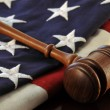 Wooden Judge's gavel atop an American Flag — Stock Photo #38781769