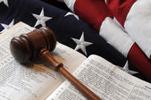 Wooden gavel, Bible and flag — Stock Photo