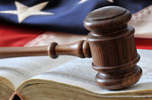 Gavel over book with flag — Stockfoto
