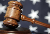 Gavel atop American flag — Stock Photo