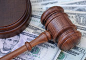 Gavel atop money — Stock Photo