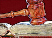 Gavel over weathered book — Stock Photo