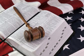 Wooden gavel, Bible, and flag — Stock Photo