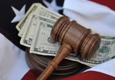 Gavel atop money and flag background — Stock Photo