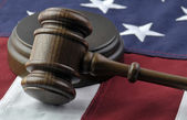 Judges gavel and American Flag — Stok fotoğraf
