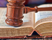 Gavel over weathered book — Foto Stock