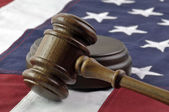 Judges gavel and American Flag — Stockfoto