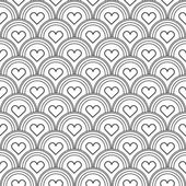 Seamless background with inscribed hearts — Stock Vector