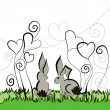 Two rabbits sitting under the flowers - Stock Vector