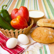 Stock Photo: Homemade bread, yogurt, tomato, paprica, eggs