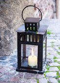 Lamp with burning candle — Stock Photo