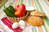 Homemade bread, yogurt, tomato, paprica, eggs — Stock Photo