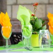 Table serving with wine glasses and bright napkins in street cafe — Stock Photo